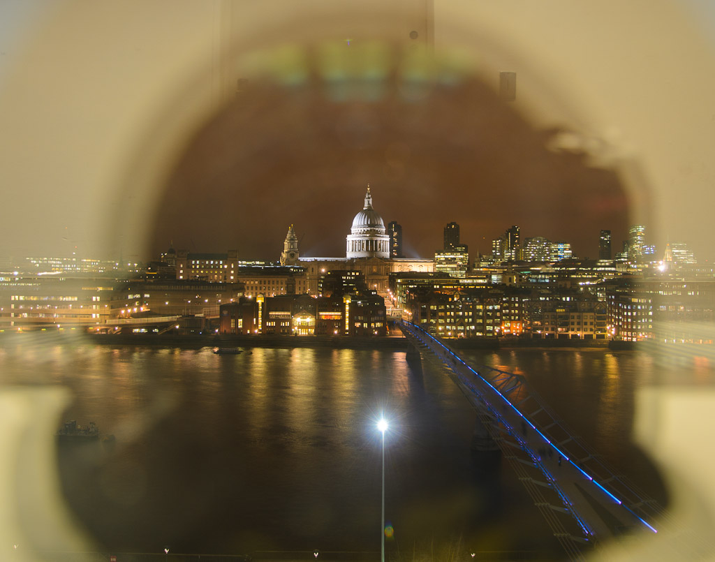 St. Paul's at night with a natural effect (no post processing) created by the glass reflection