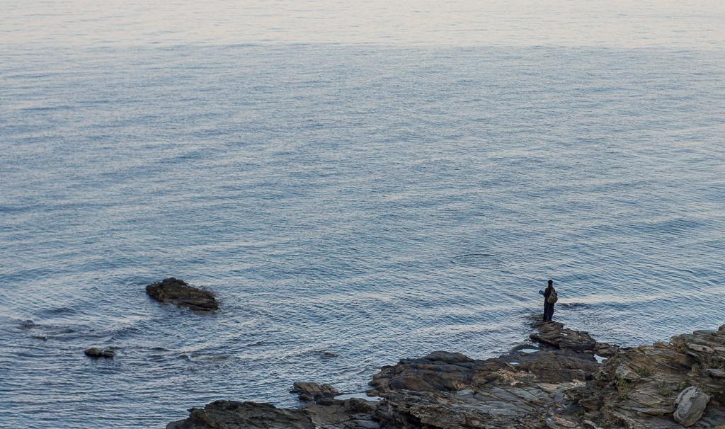Monk, fishing near Mylopotapos area