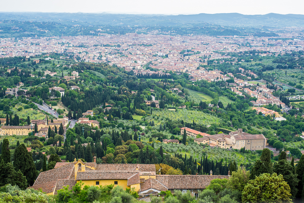 View of Florence from Fiesole. Fiesole provides nice views and a peaceful walk around forest hills and an ancient theatre. Several walking paths start or end in Fiesole.